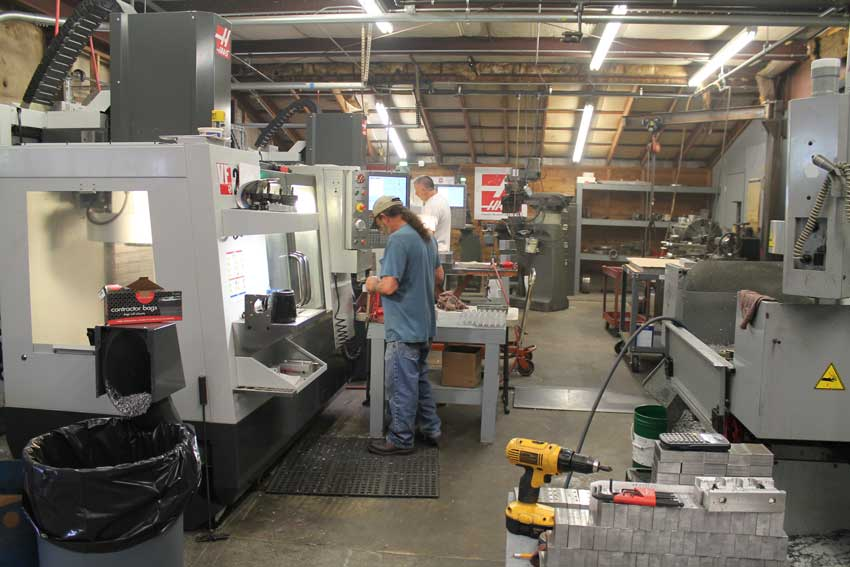 Employees working with Haas equipment